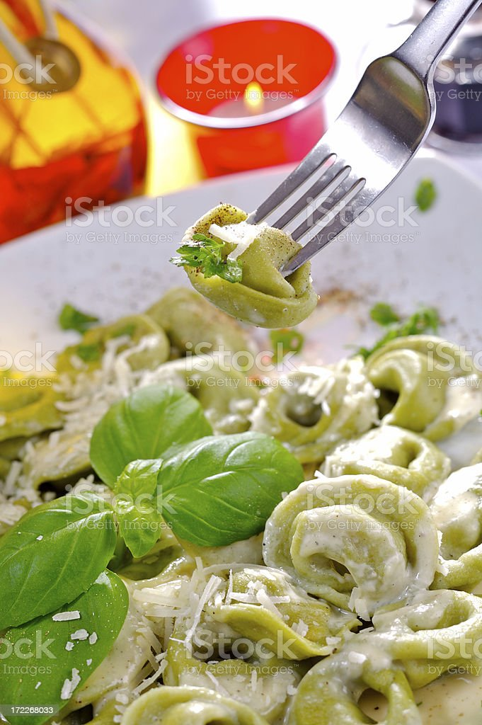 Ravioli with spinach and gorgonzola sauce royalty-free stock photo