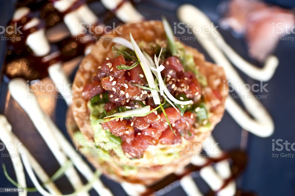 Raw Ahi Tuna and guacamole tostadas stock photo