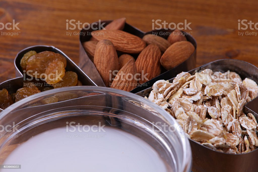 Raw almond and whole grain cereals stock photo