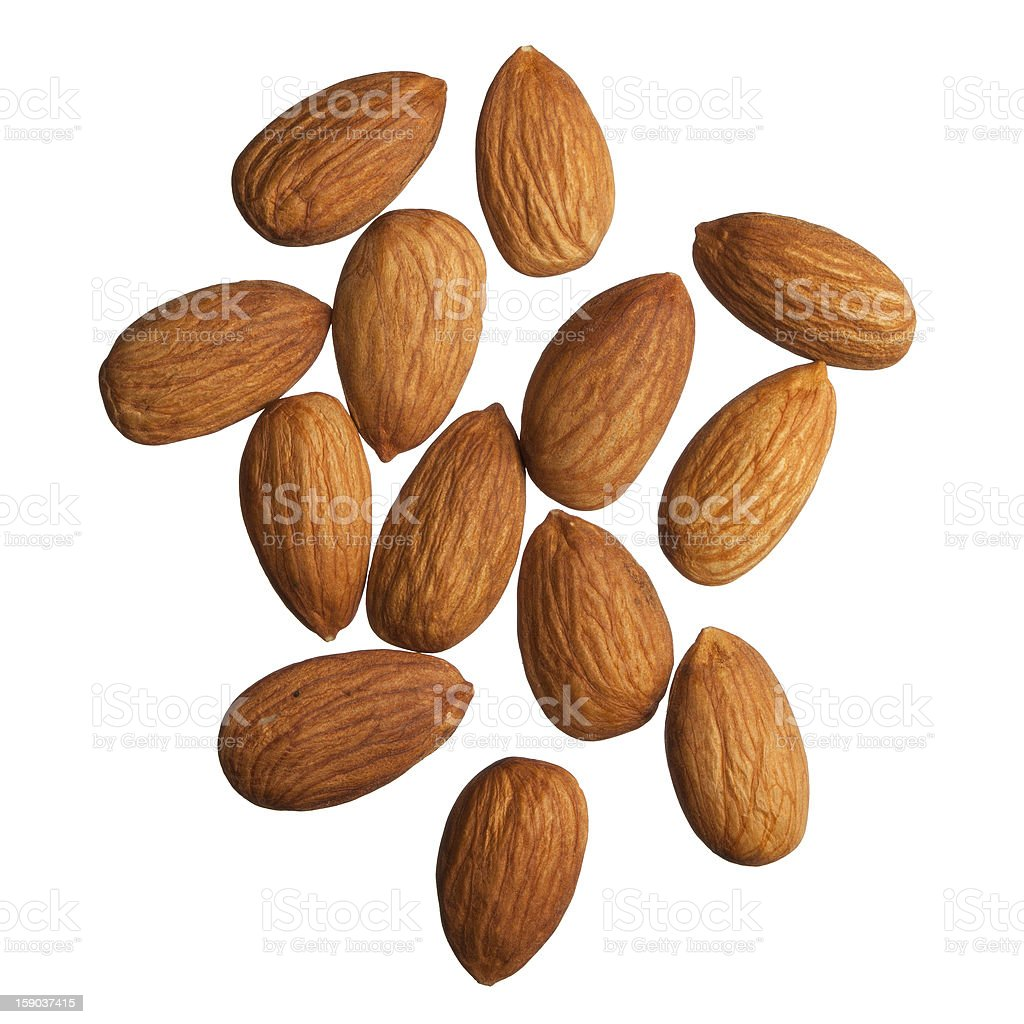 13 raw almonds against white background stock photo