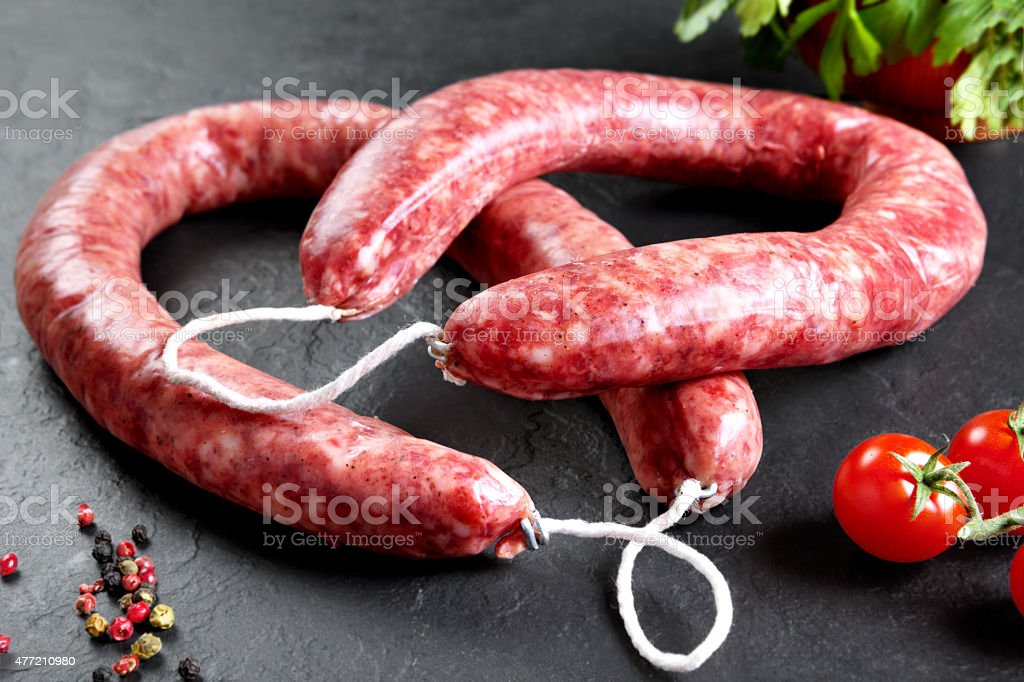 Raw and fresh meat. Fresh sausages ready to cook stock photo