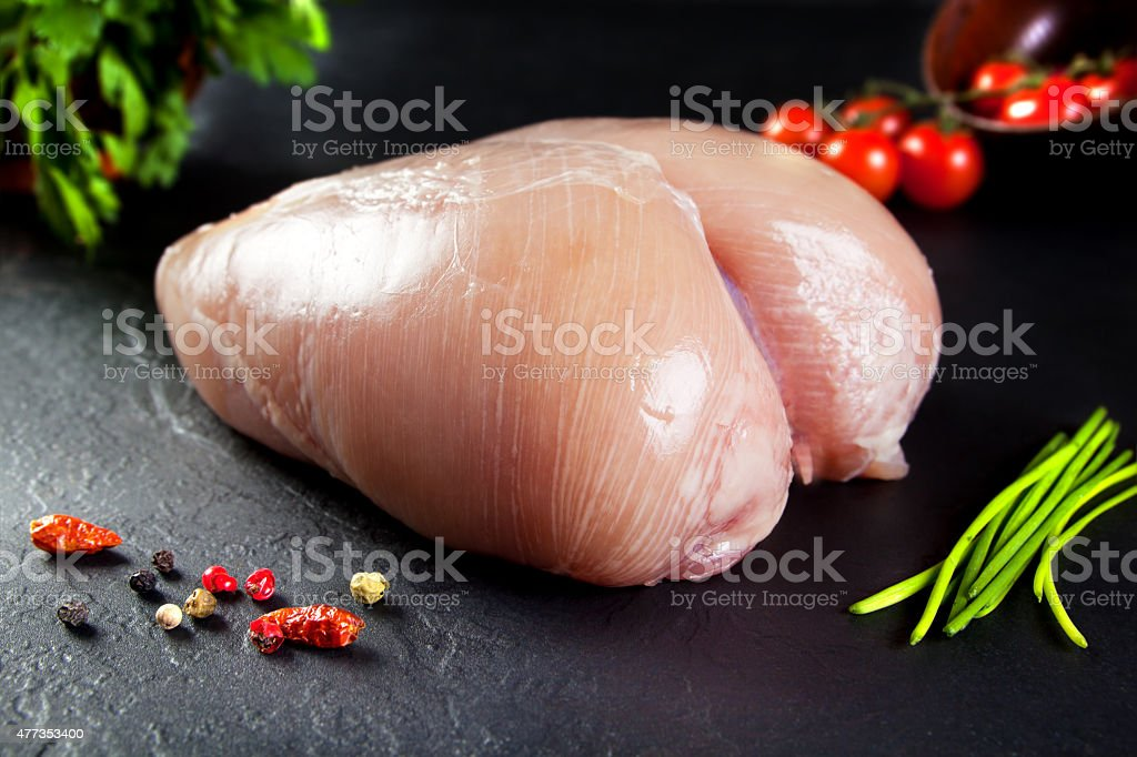 Raw and fresh meat. whole uncooked chicken breast without cutting stock photo