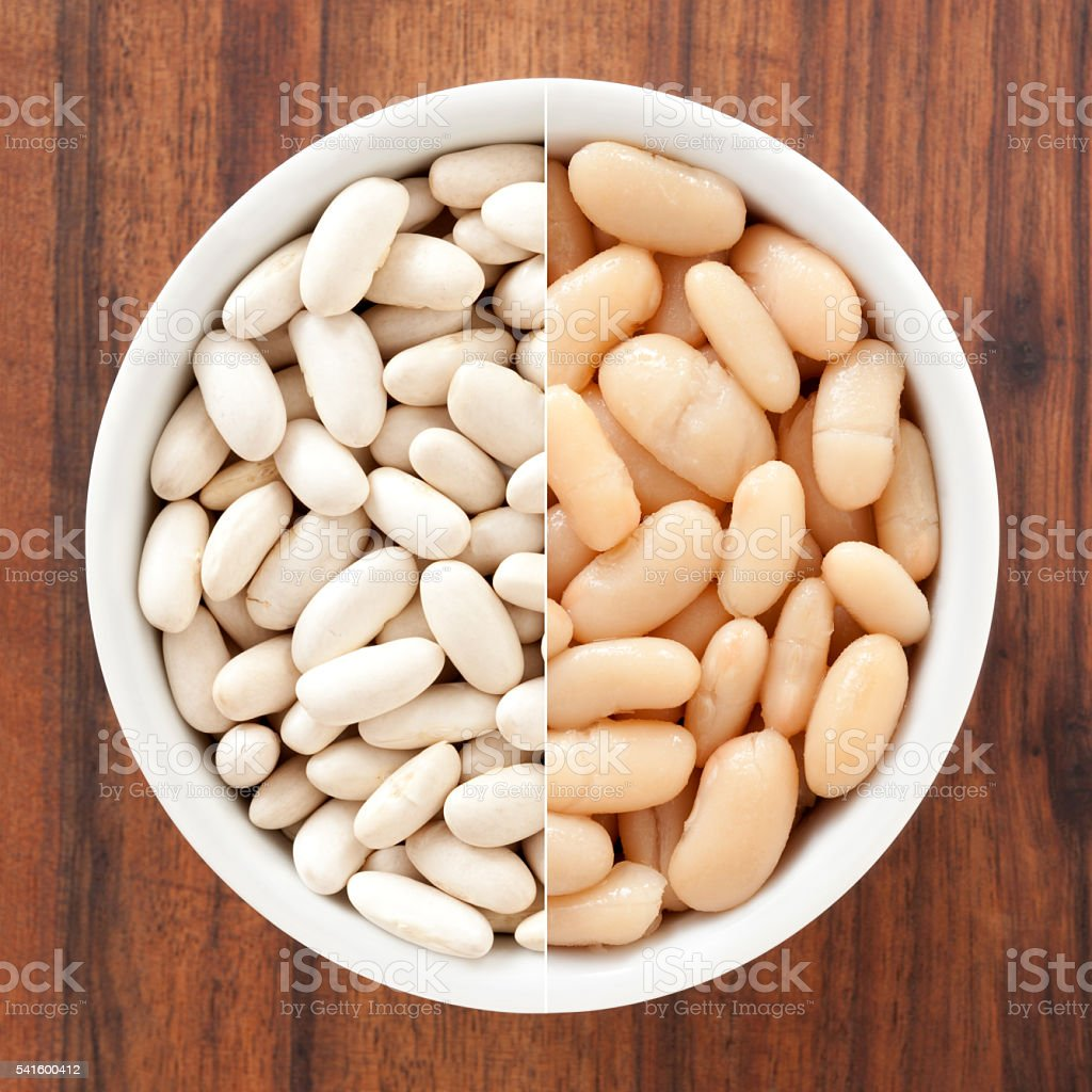 Raw and soaked cannellini beans composition stock photo