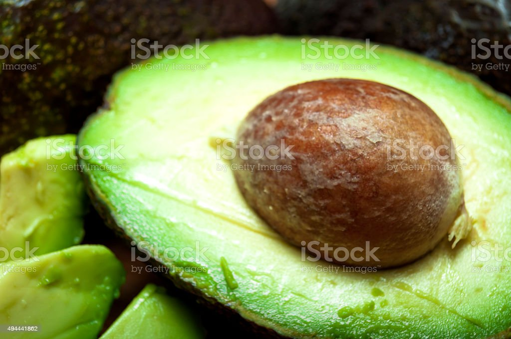 Raw avocado sliced in half stock photo