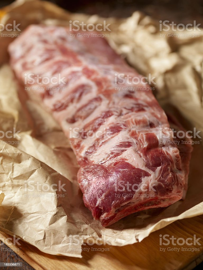Raw Baby Back Pork Ribs in Butcher Paper royalty-free stock photo