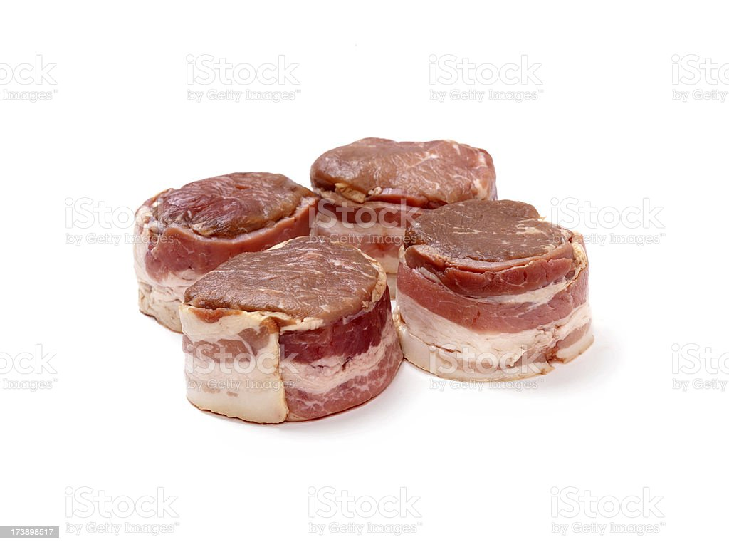 Raw Bacon Wrapped Steaks royalty-free stock photo