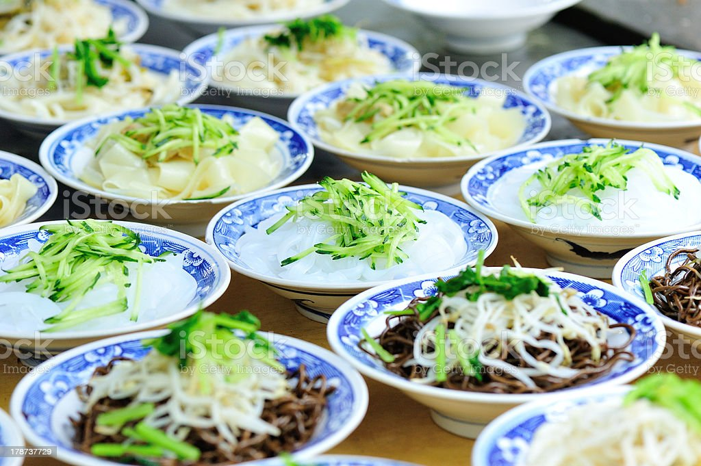 raw bean jelly and noodles in dishes on a table royalty-free stock photo