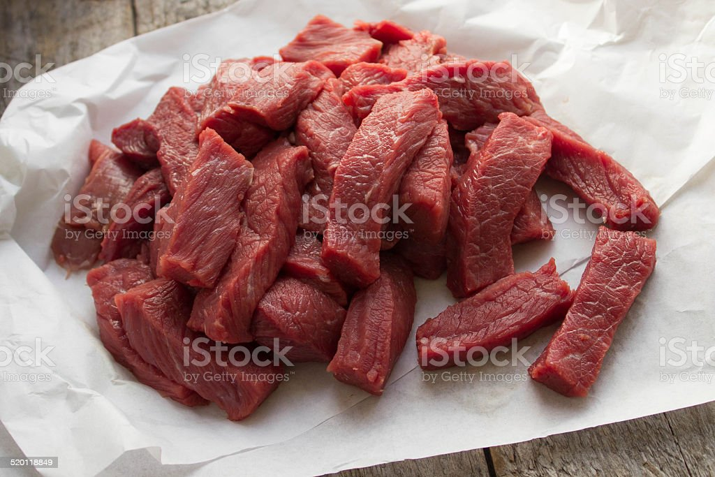 raw beef, chopped into small pieces stock photo