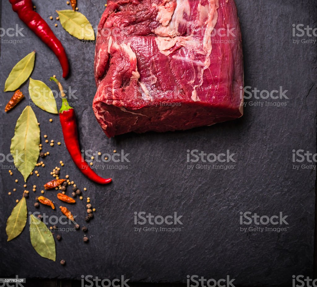 raw Beef meat  fillet with spices on black slate stock photo