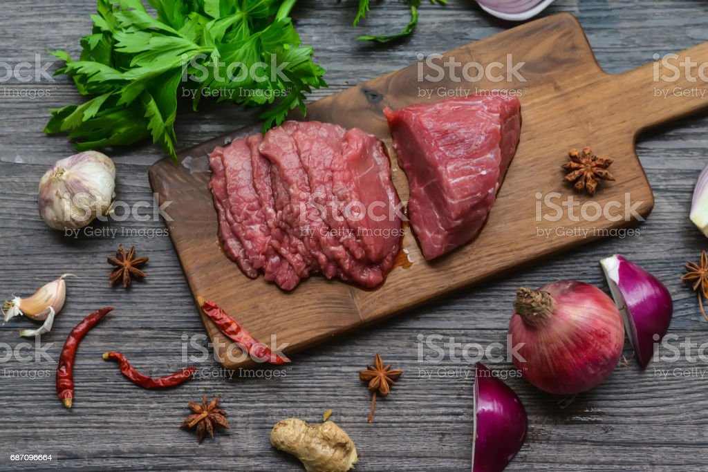 Raw beef meat on a cutting board stock photo