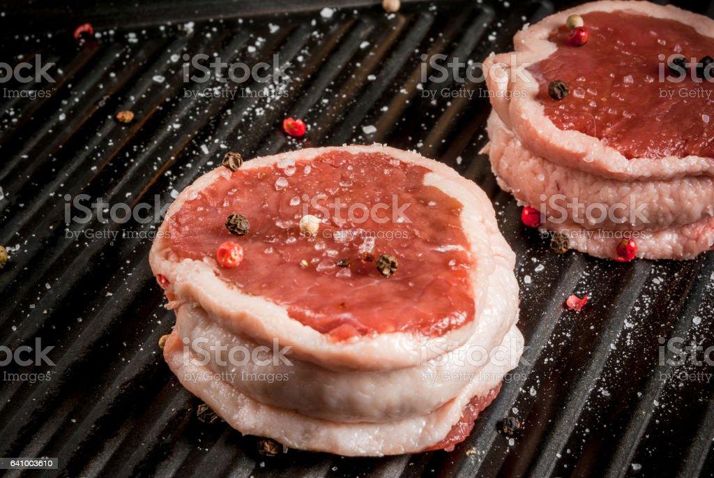 Raw beef medallions stock photo