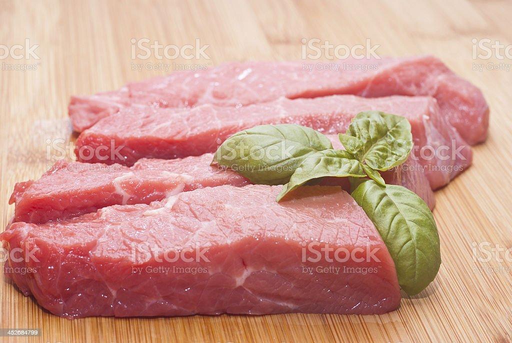 Raw beef on cutting board stock photo