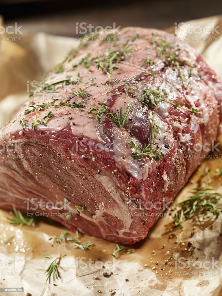 Raw Beef Roast with Fresh Herbs stock photo