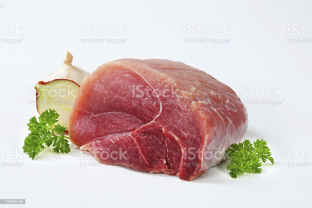 Raw beef shoulder with onion and garlic royalty-free stock photo