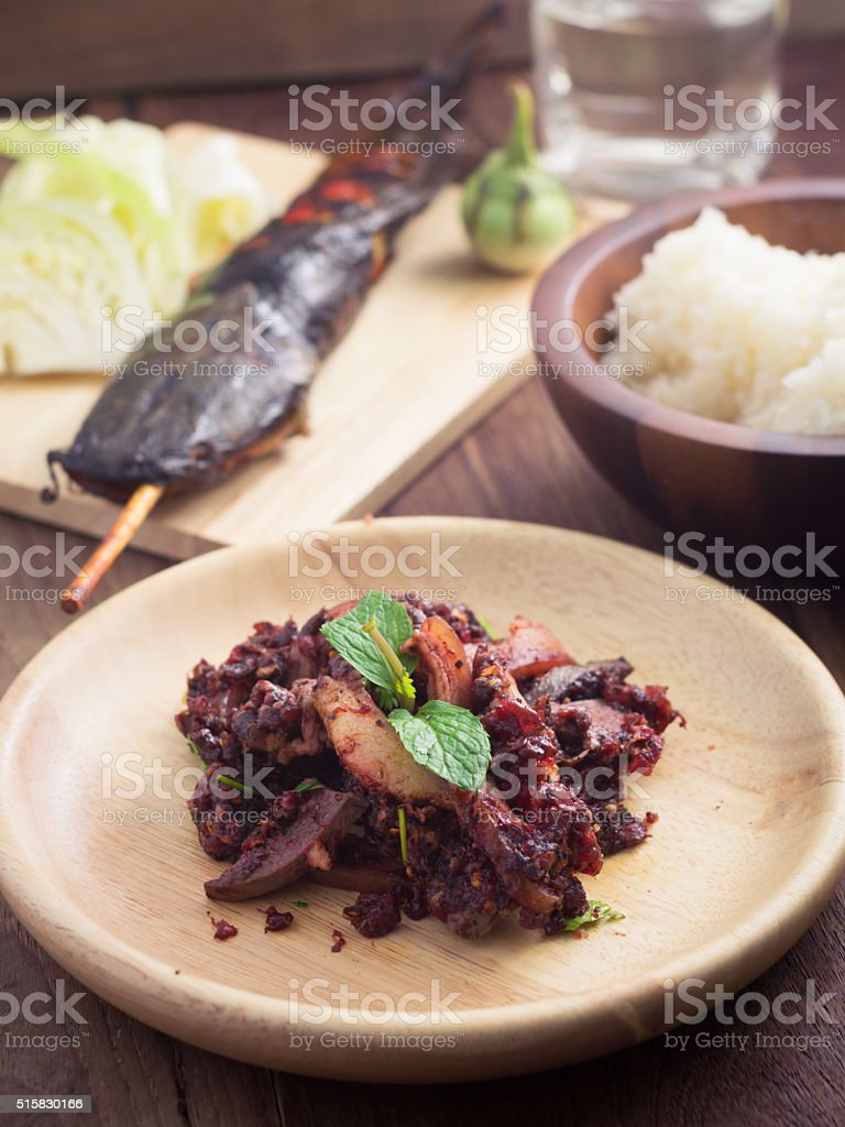 Raw beef spicy minced with blood salad stock photo