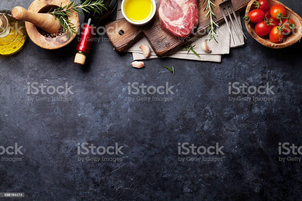 Raw beef steak cooking stock photo