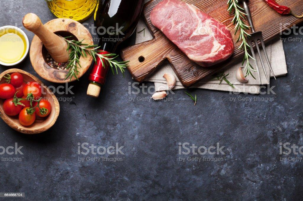 Raw beef steak cooking stock photo