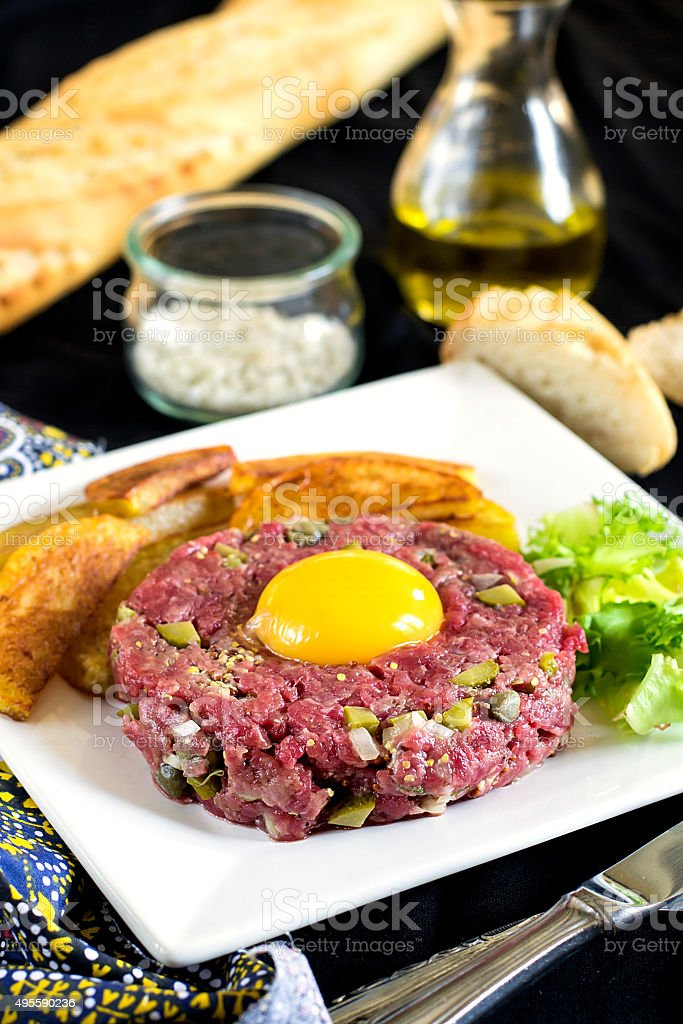 Raw beef steak tartare with French fries stock photo