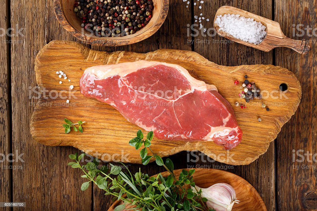 Raw beef striploin steak. Uncooked meat New York strip steak. stock photo