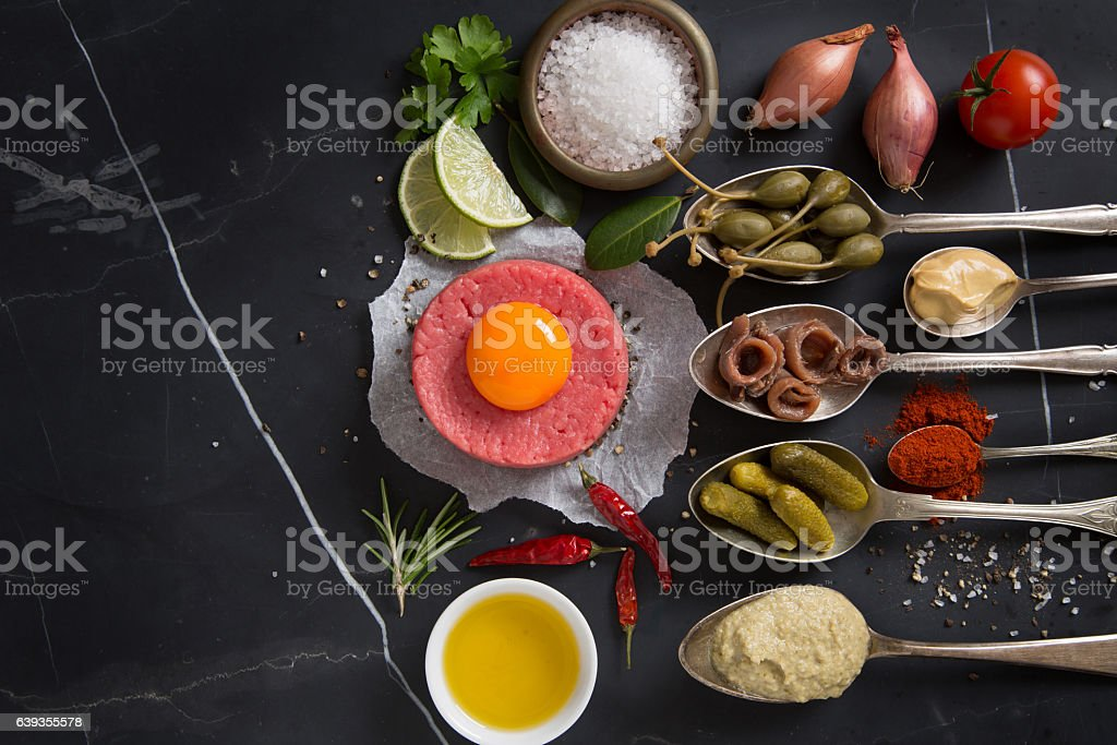 Raw beef with ingredients stock photo