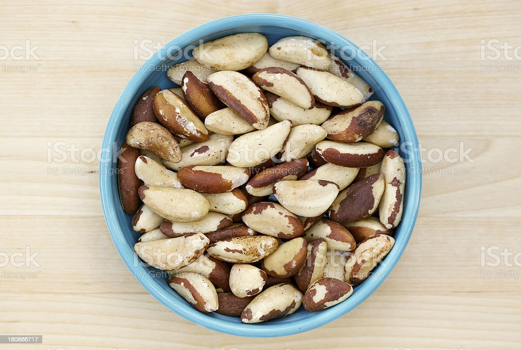 Raw Brazil nuts in bowl from directly above royalty-free stock photo