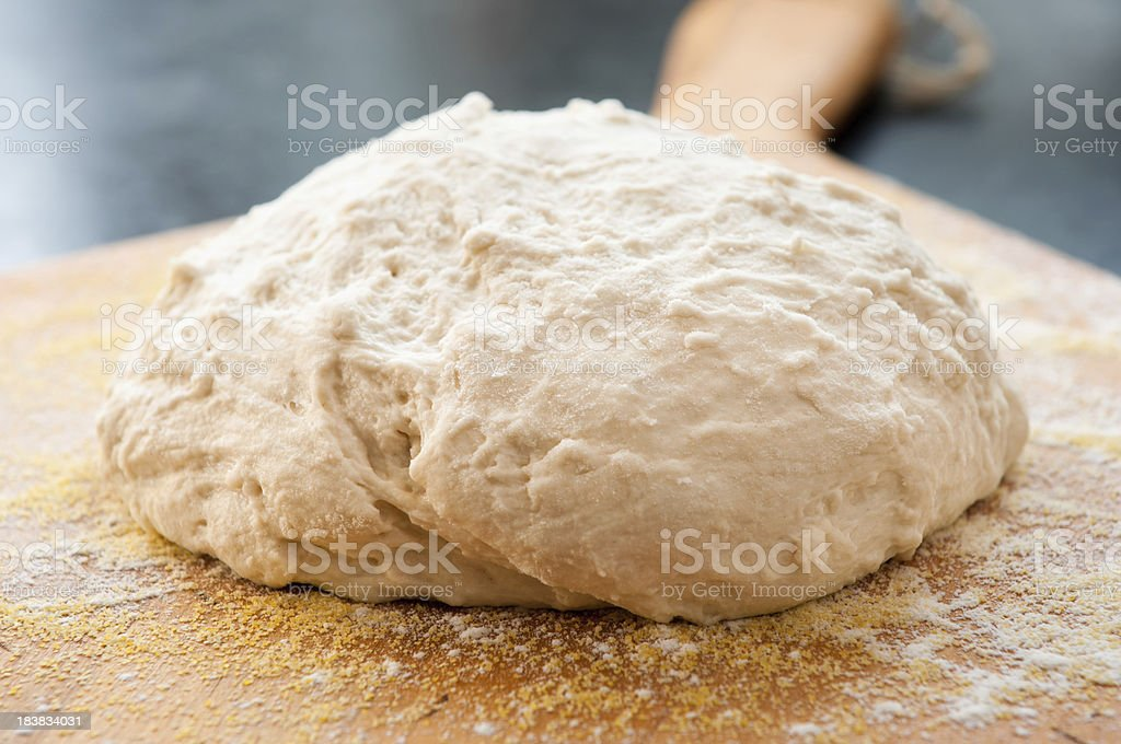 Raw Bread Dough sitting on Paddle stock photo