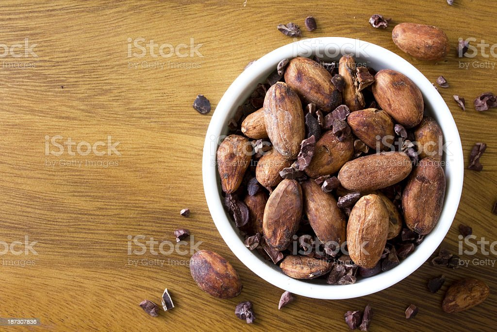 Raw Cacao beans and nibs stock photo