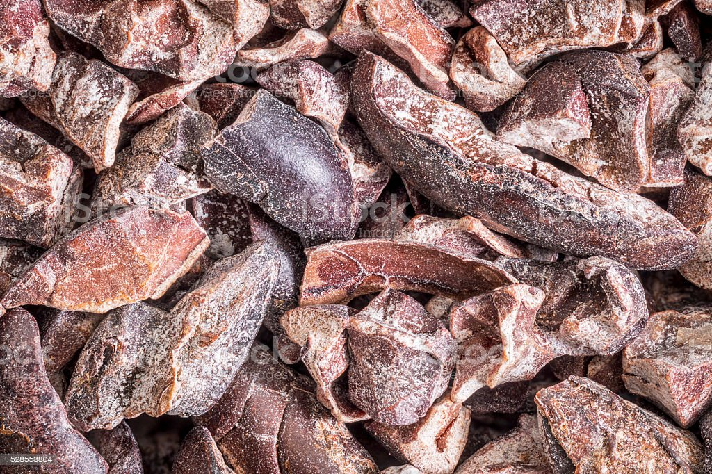 raw cacao nibs background stock photo