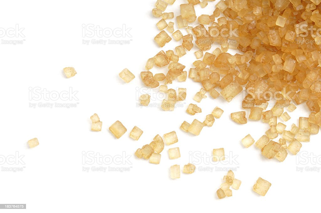 Raw Cane Sugar Scattered royalty-free stock photo