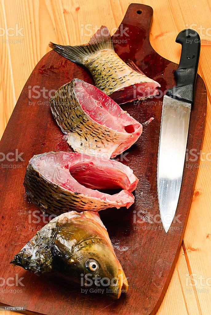 Raw carp fish  on a wooden board royalty-free stock photo