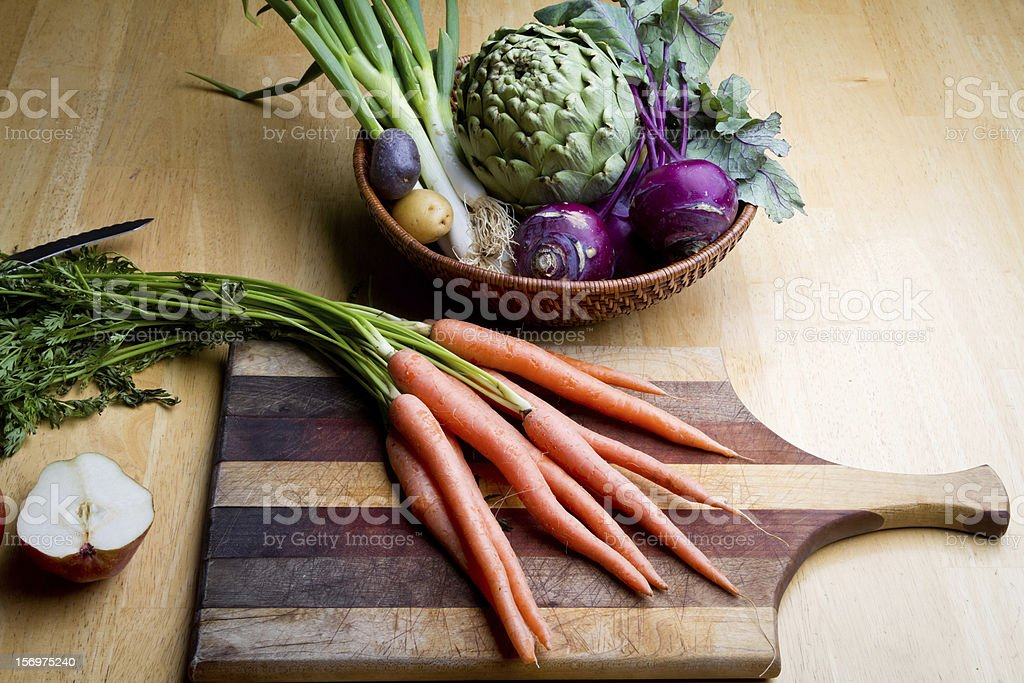 Raw Carrots and Kohlrabi with Cutting Board royalty-free stock photo