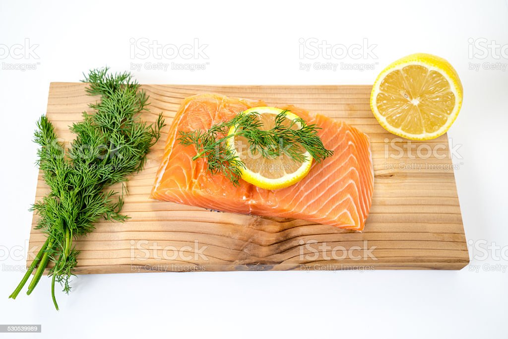 Raw Cedar Plank Salmon stock photo