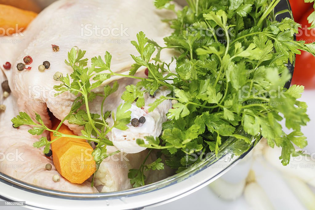 Raw chicken and vegetables in a soup pot royalty-free stock photo