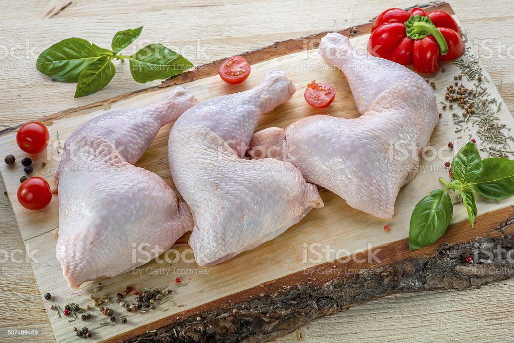 Raw chicken breasts on wood stock photo