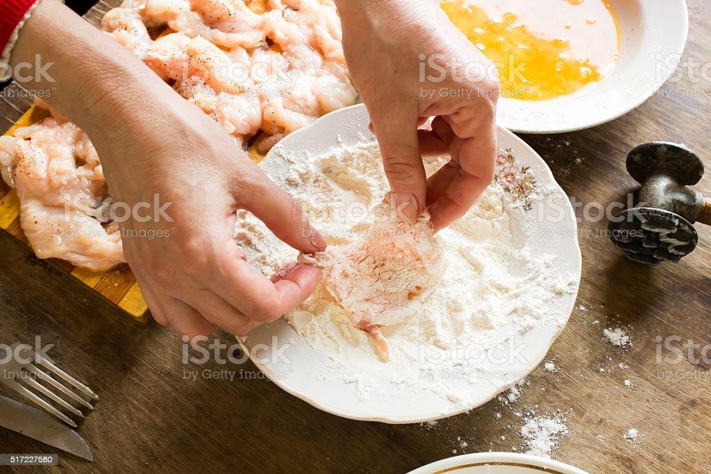 Raw chicken fillet in flour stock photo