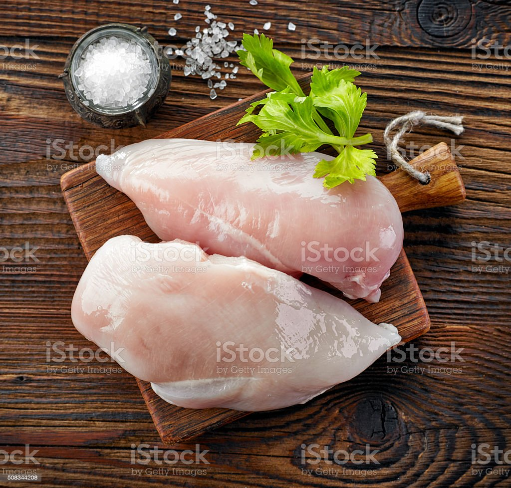 raw chicken fillets stock photo