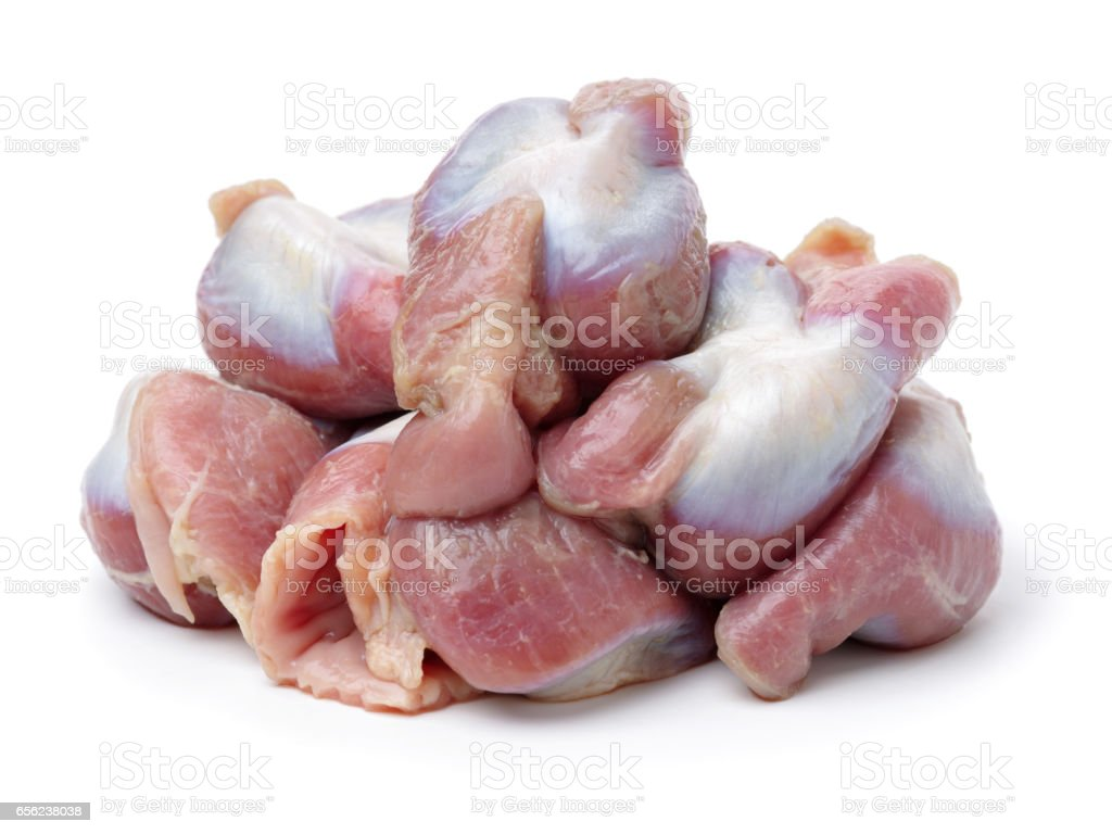 Raw Chicken gizzards on white background stock photo