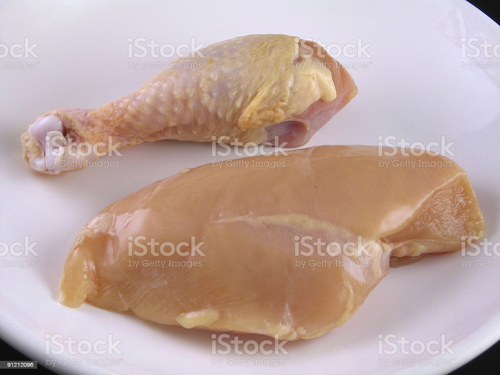 Raw chicken isolated on white plate stock photo