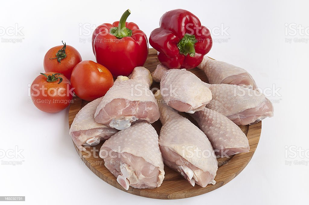 raw chicken leg and vegetables royalty-free stock photo