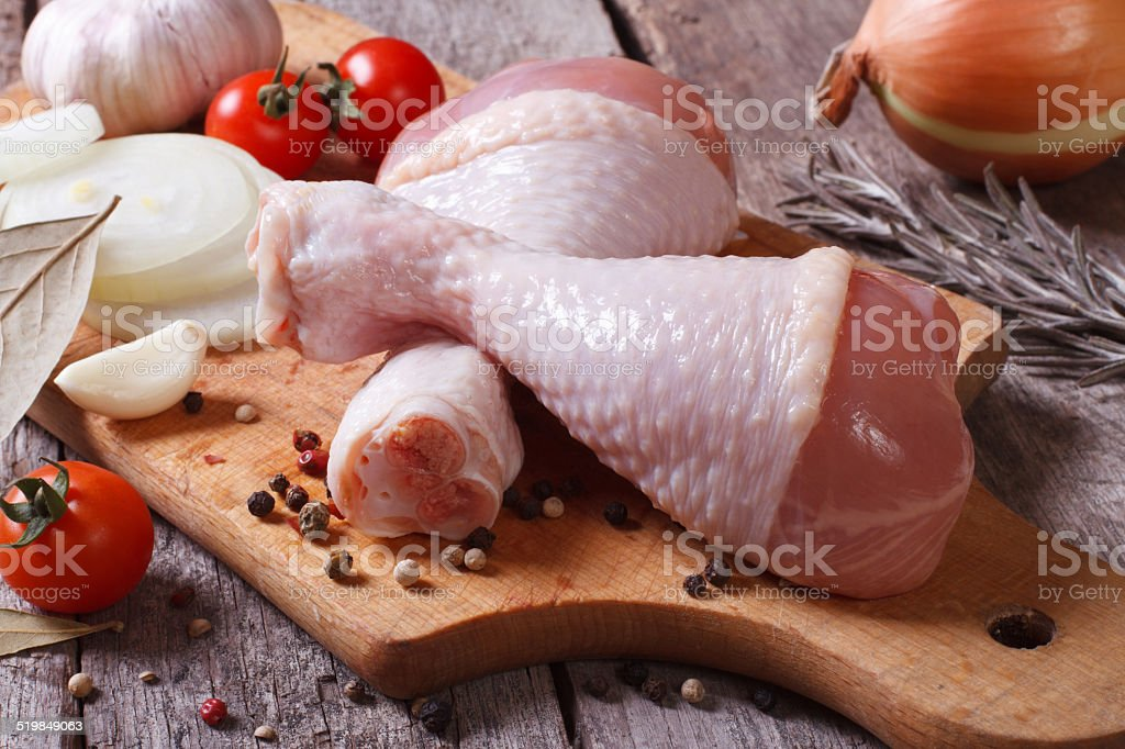 raw chicken legs and marinade ingredients stock photo