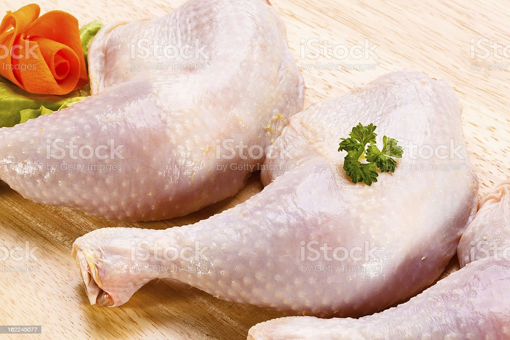 Raw chicken legs on cutting board royalty-free stock photo