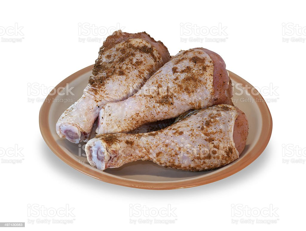Raw chicken legs on plate isolated royalty-free stock photo