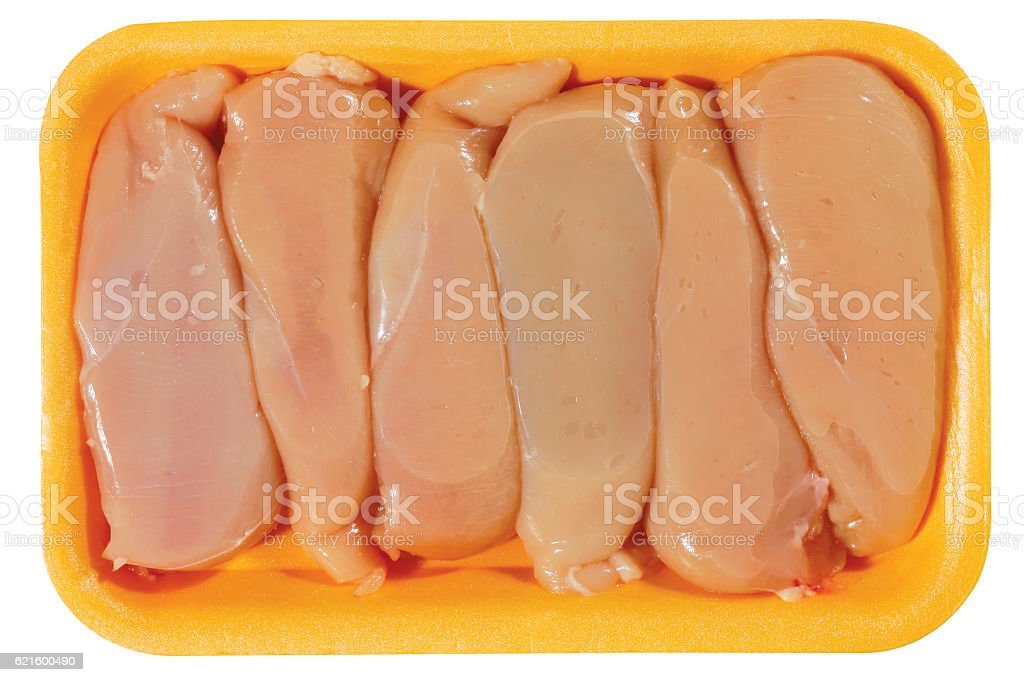 raw chicken meat in plastic tray isolated on white background stock photo