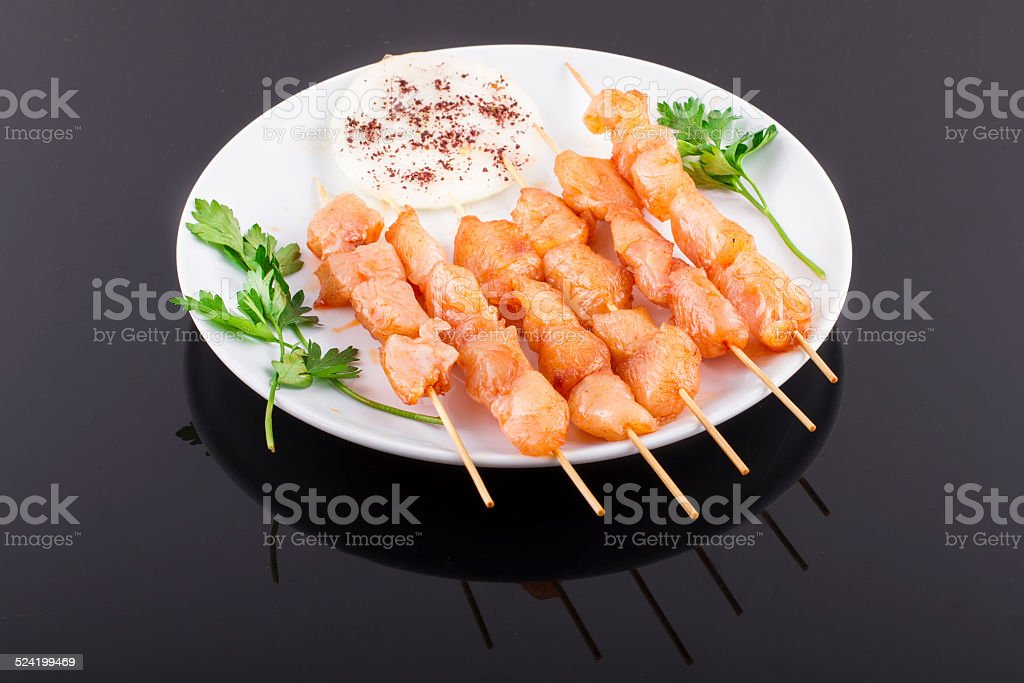 Raw Chicken Skewers On Plate stock photo