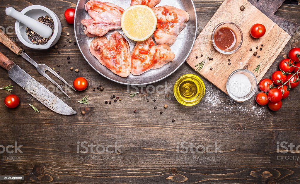 raw chicken wings barbecue sauce peppers, herbs,  ,place text stock photo