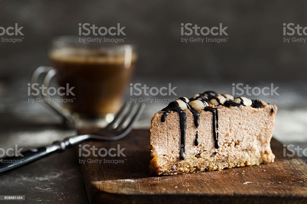 Raw chocolate mousse cake with  hazelnuts, coffee. Grey background stock photo