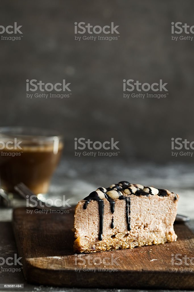 Raw chocolate mousse cake with  hazelnuts, coffee. Grey background stock photo
