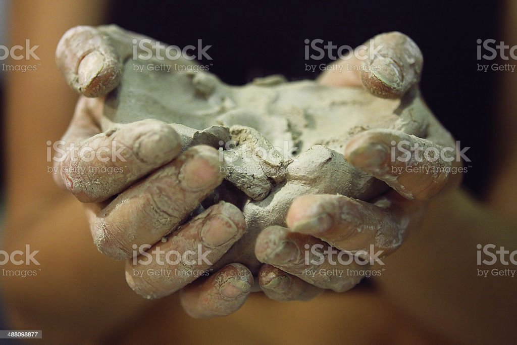 Raw clay in the hands of women stock photo