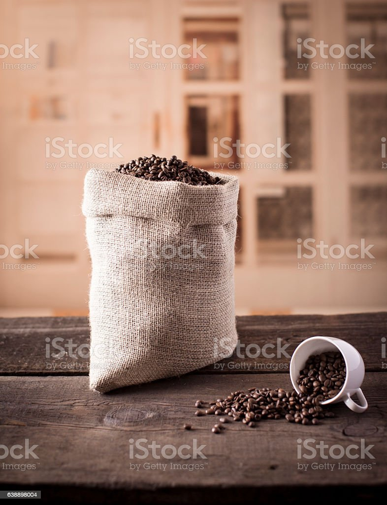Raw coffee beans in cup stock photo