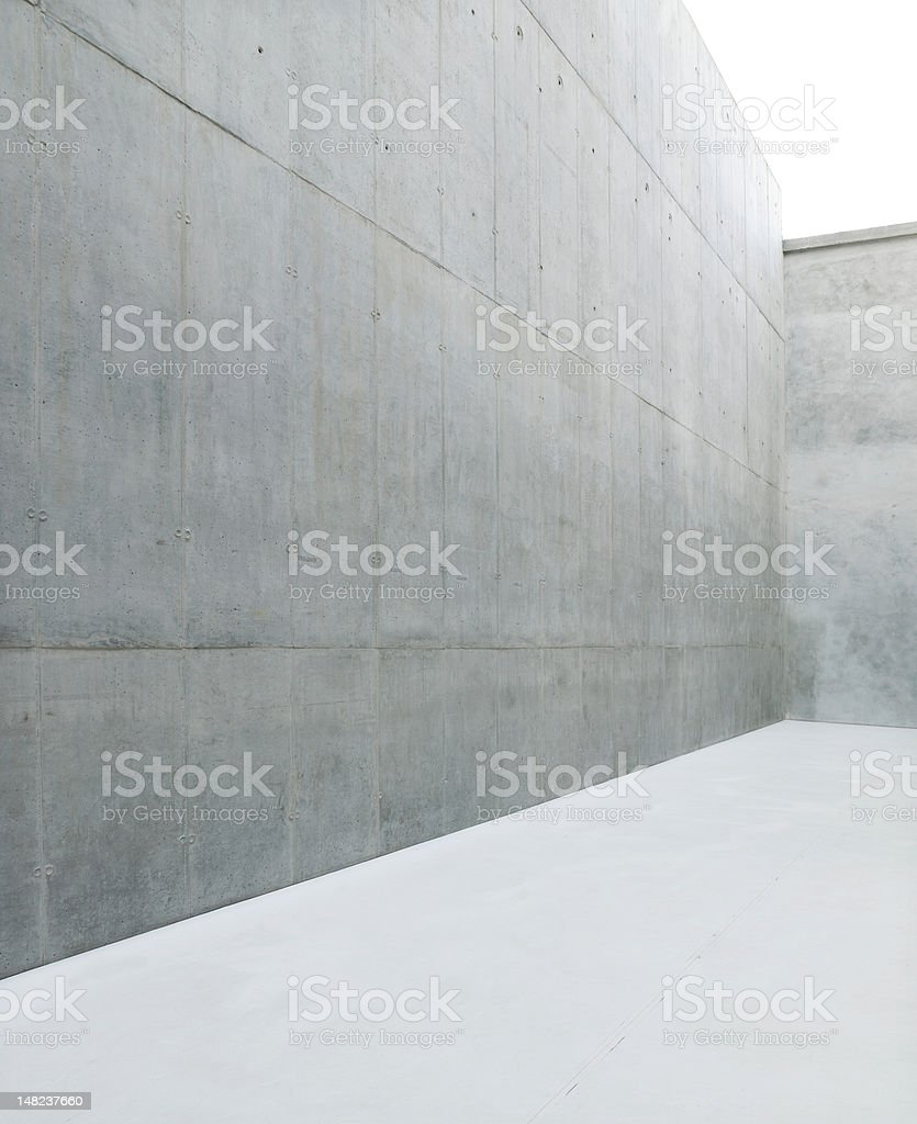 Raw concrete wall with white floor  stock photo